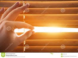 looking through window blinds sun light coming inside stock