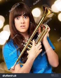 confused holding trumpet outdoor stock photo 109232546