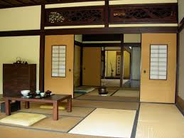 yellow wall paint with sliding door in japanese interior design of