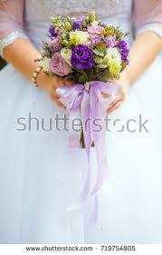 Purple Wedding Flowers Hands Bride Groom Rings On Wedding Stock Photo 550349296