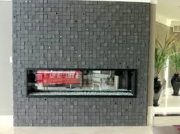see through gas fireplace with amazing square tile work by marquis