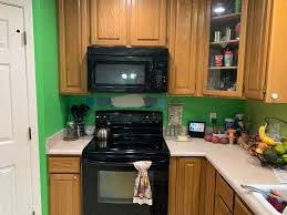 green kitchen paint with oak cabinets help save me from my lime green kitchen with honey oak need