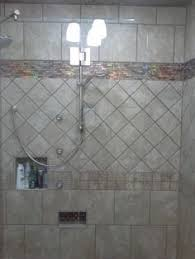a completely tiled bathroom by custom home interiors in charlotte