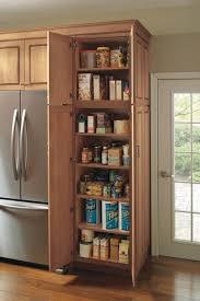 wooden kitchen pantry cupboard utility storage cabinet schrock cabinetry