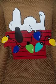 snoopy doghouse christmas decoration snoopy doghouse christmas door hanger by thepaisleypersimmon 50 00
