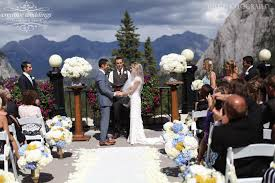 wedding backdrop calgary wedding ceremony on the outdoor terrace at the fairmont banff