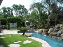 outdoor a courtyard with a garden and pond to the right and then