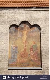 religion christianity jesus christ crucifixion mural painting on stock photo religion christianity jesus christ crucifixion mural painting on the isartor city gate munich germany facade facades
