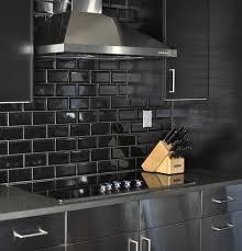 white kitchen cabinets with black subway tile backsplash bright black beveled naturali