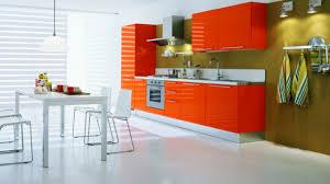 orange kitchen cabinets awesome orange kitchen cabinets with green and white backsplash