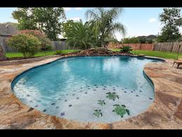 Blue Haven Pools Tulsa by Free Form Pool With Boulder Weeping Wall Toe Tiles At Steps And