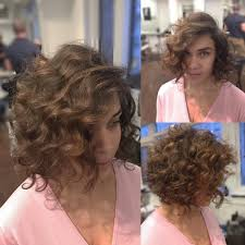 soft curl hairstyle women s brunette angled bob with large soft curls and side part