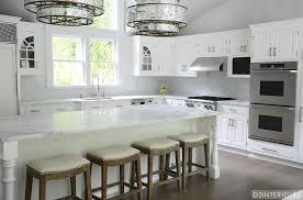 wooden legs for kitchen islands white beadboard kitchen island with turned legs contemporary