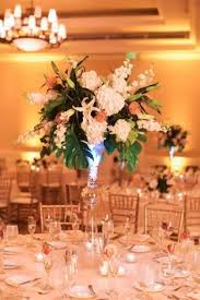 Tall Wedding Reception Centerpieces by Tall Pink Cream And Lilac Rose And Hydrangea Centerpieces On