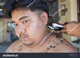 fat man getting haircut by hairdresser fotka 382765507 shutterstock