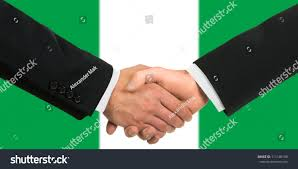 Nigerian Flag Nigerian Flag Business Handshake Stock Photo 111140198 Shutterstock