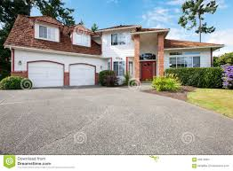 rs garage doors american large white house with two garage dors red door and
