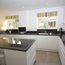 black worktop white cupboards kitchen white gloss kitchen with black granite worktops worcester