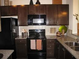 kitchens with white cabinets and black appliances black kitchen appliances white cabinets free standing kicthen island