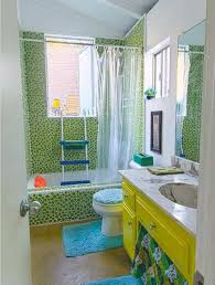 tiny bathrooms green mosaic tiles and yellow vanity with marble