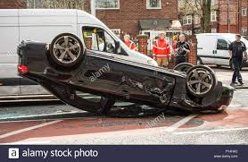 black audi road traffic accident black audi rolled over on its roof police