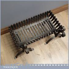 good sized vintage fire grate and wrought iron dogs 21