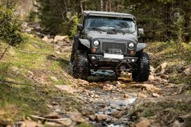 rally jeep wrangler off road extreme expedition on black jeep wrangler in mountain