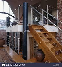 open tread wooden staircase to mezzanine floor in large open plan