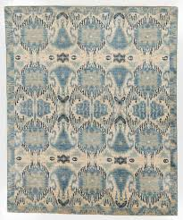 excellent ikat rug with a border dark blue and tan area rugs