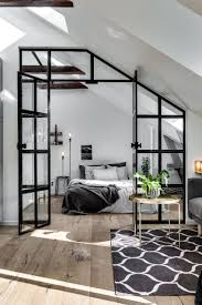 best 25 attic design ideas on pinterest wood partition bedroom attic apartment with an industrial glass wall gravity home