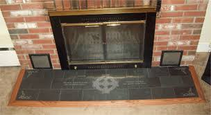 handmade engraved slate fireplace hearth with celtic and english