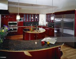 Red Cabinets Kitchen by Hi Tech Kitchen With Red Cabinets Stock Photo Getty Images