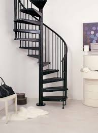 black metal spiral staircase connected by white wall theme and