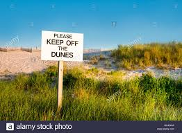 keep off the beach grass and sand dunes sign cape cod
