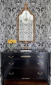 half bath design with black vanity cabinet and ornate mirror and