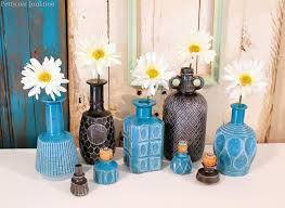 How To Paint A Vase Diy Spray Paint Glass Decanters For Home Decor Petticoat Junktion