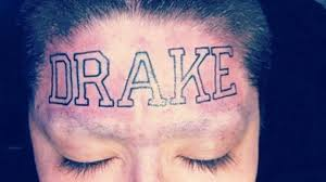 drake reacts to the woman who tattooed his name on her forehead