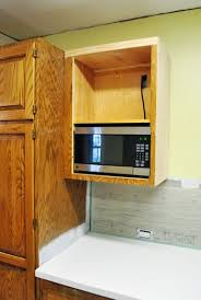 microwave in cabinet shelf how to hide a microwave building it into a vented cabinet young