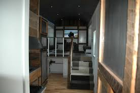 a 320 square feet tiny house with slide outs and built on a