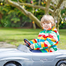 kid play car funny kid boy driving big toy old vintage car and having fun