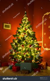 beautiful christmas living room decorated christmas stock photo beautiful christmas living room with decorated christmas tree gifts and fireplace with the glowing lights