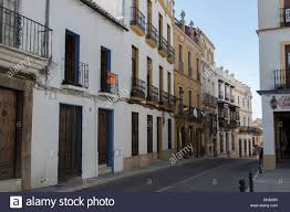 typical street scene of spanish houses in the city of ronda spain