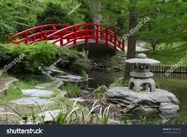 Japanese Style Garden by Red Bridge Japanese Style Garden On Stock Photo 76036039
