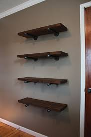 Making Wooden Shelf Brackets by Pipe Bracket Shelving I Like Galvanized Pipes And Salvaged Wood To