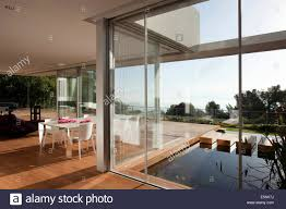 open plan dining room with view through full length windows to