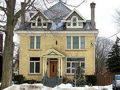 yellow brick with black trim yellow brick houses black trim and