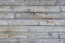 faded wooden wall paneling for background weathered wooden