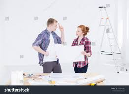 young man woman work clothes discussing stock photo 417419365