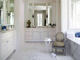 master bath with white cabinets and vanity seat intended for