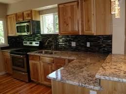 black backsplash white granite countertops the look i think i u0027m